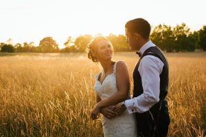 Bride and Groom in the sunset laughing at Stock Brook Country Club, Wedding Photography