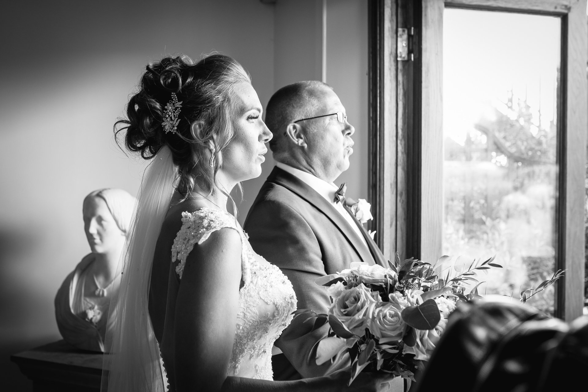 Bride and her father taking a breath before walking down the aisle
