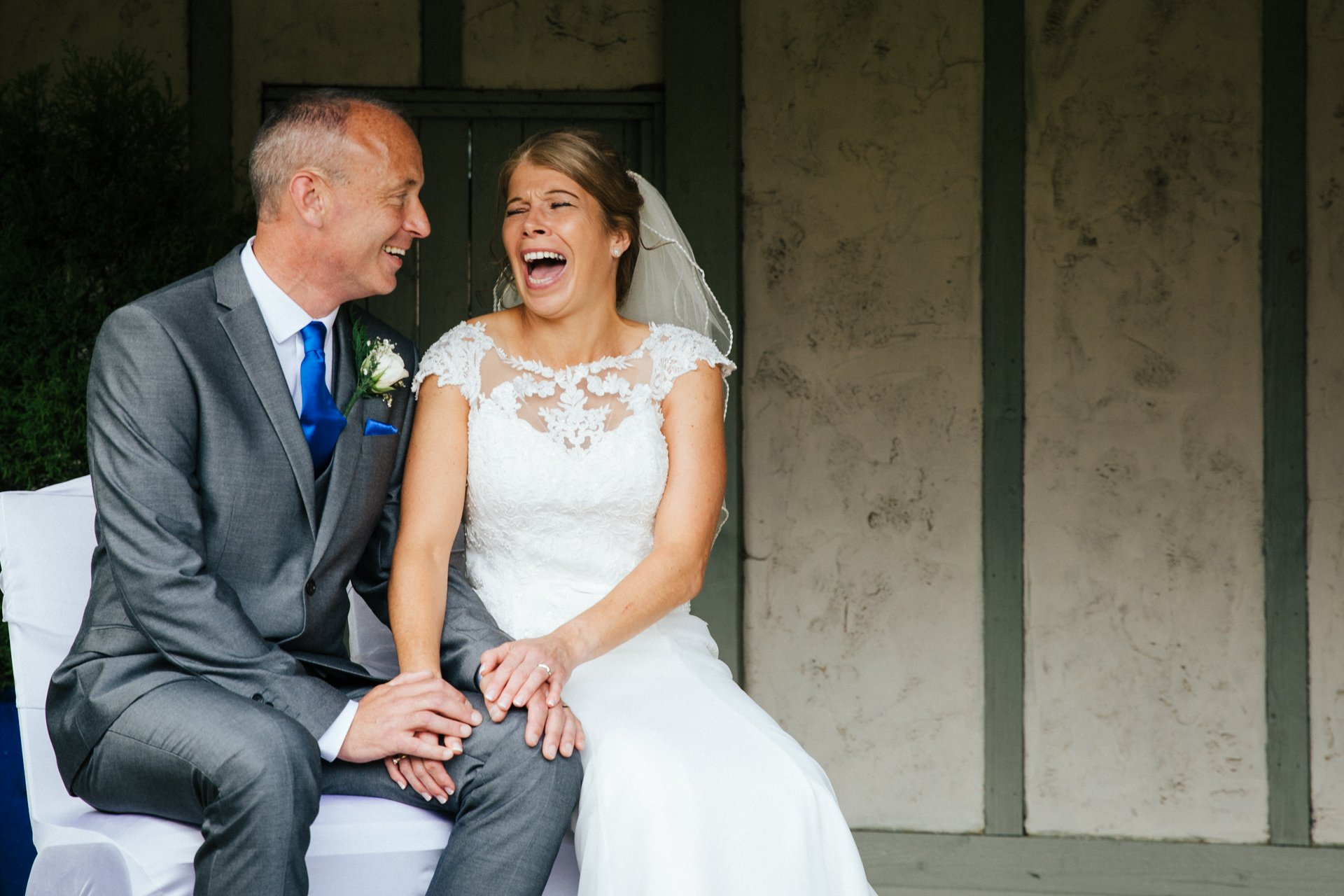 Smiling, relaxed couple on their wedding day, at Cooling Castle Barn Kent, Wedding Photography Kent