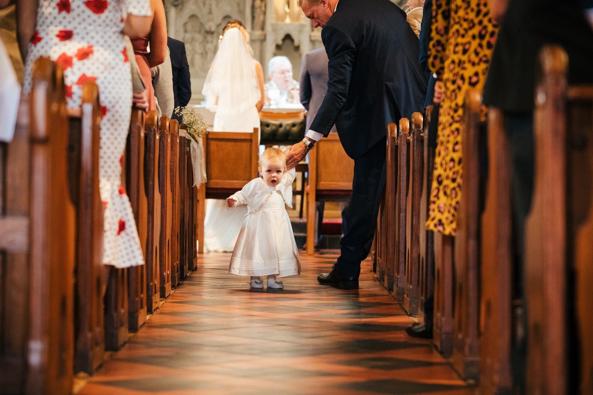 Young child tried to escape from he church int he middle of ceremony