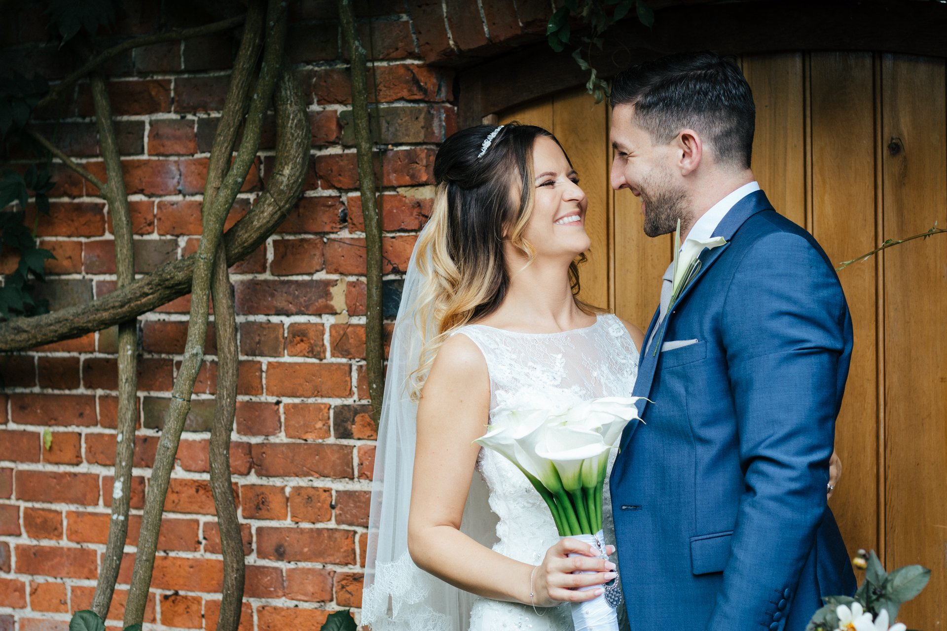 Smiling, relaxed couple on their wedding day, at Blake Hall, Wedding Photography Kent