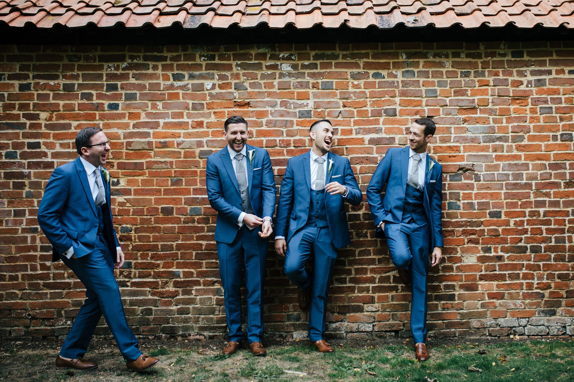 Groom and Groomsmen laughing during wedding group shot