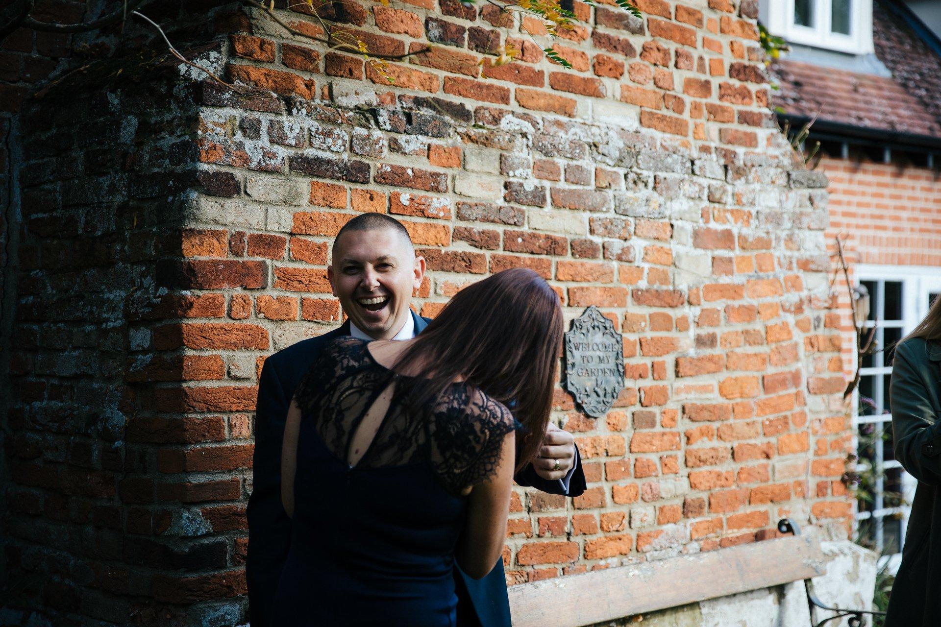 Best man laughing during wedding preparations