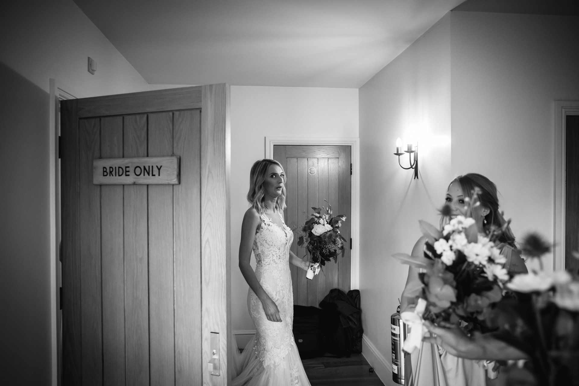 Bride pulls face as she exits Bride Only room before wedding