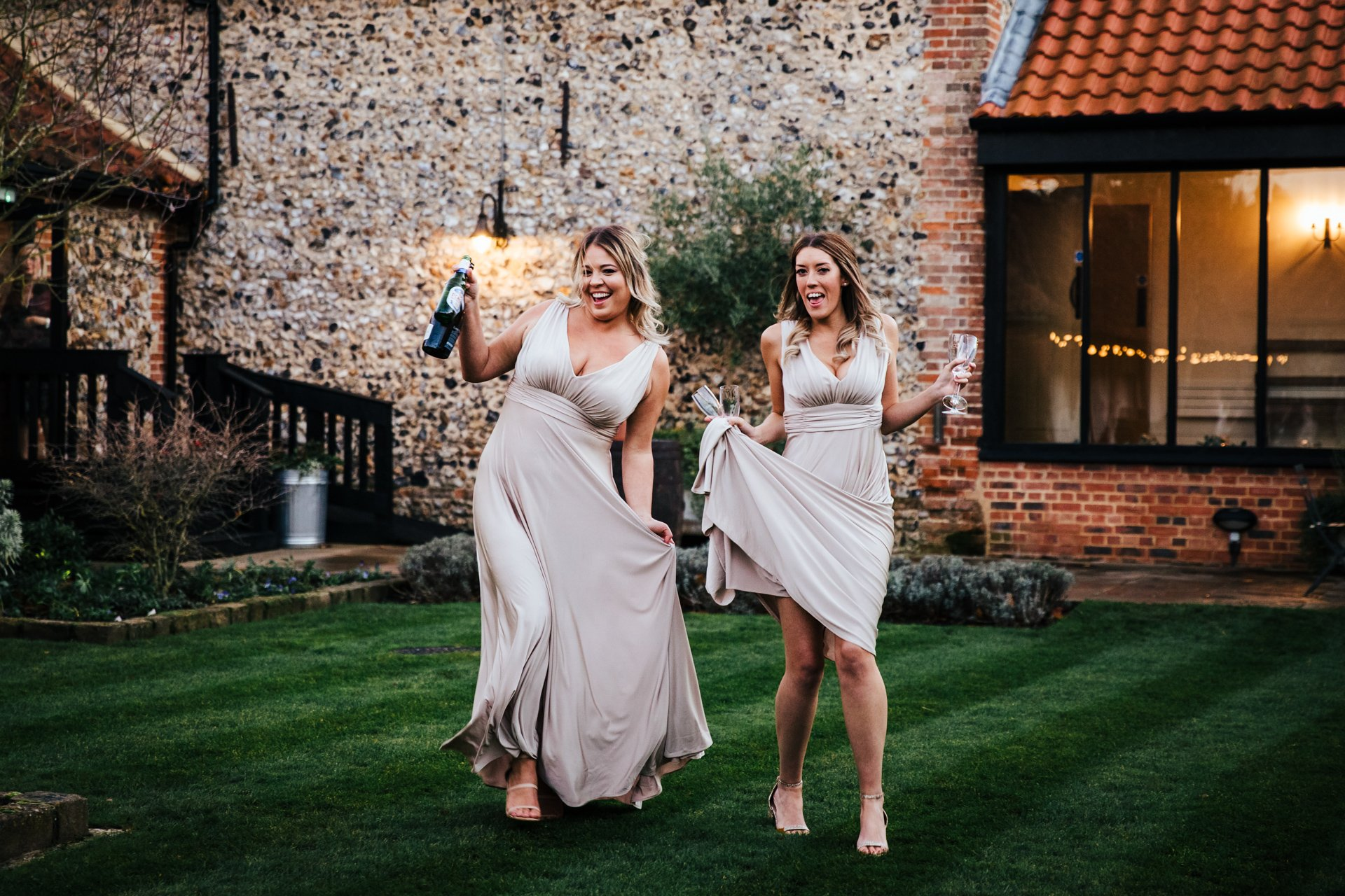 bridesmaid with Prosecco during wedding portraits
