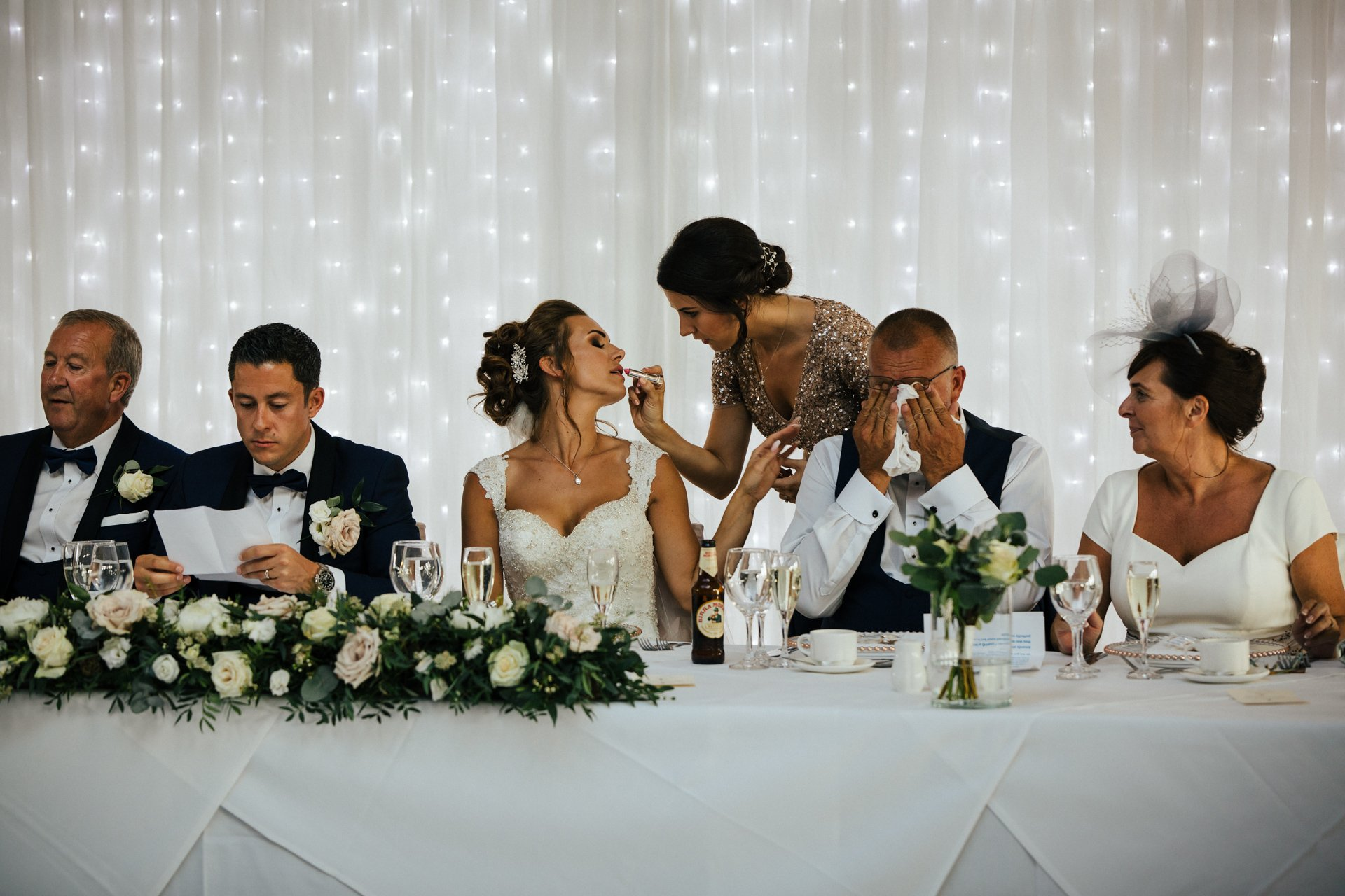 Bridal party seated at top table preparing for speeches