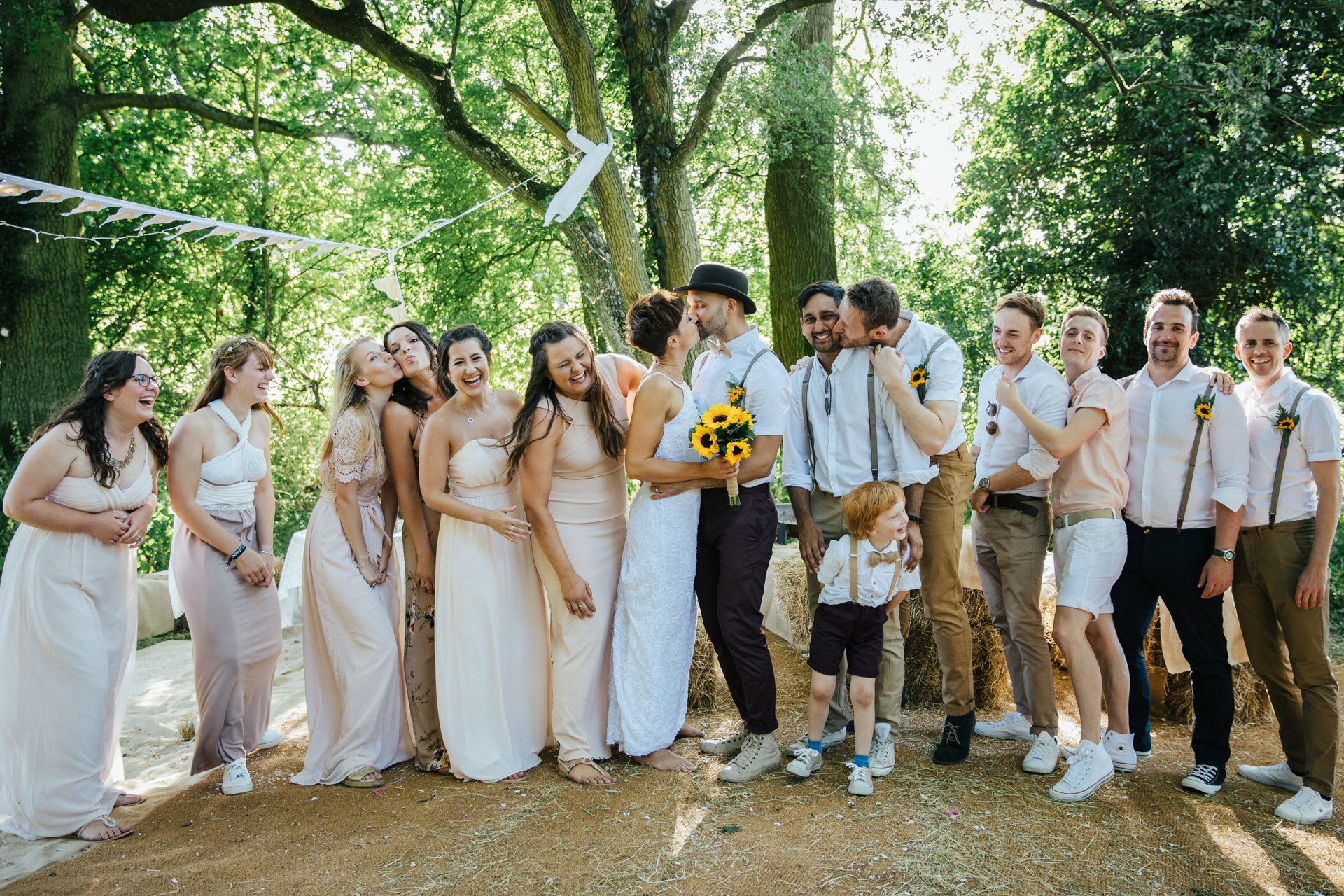 Bridal party laughing in a group shot at Love2yurt, Wedding Photography