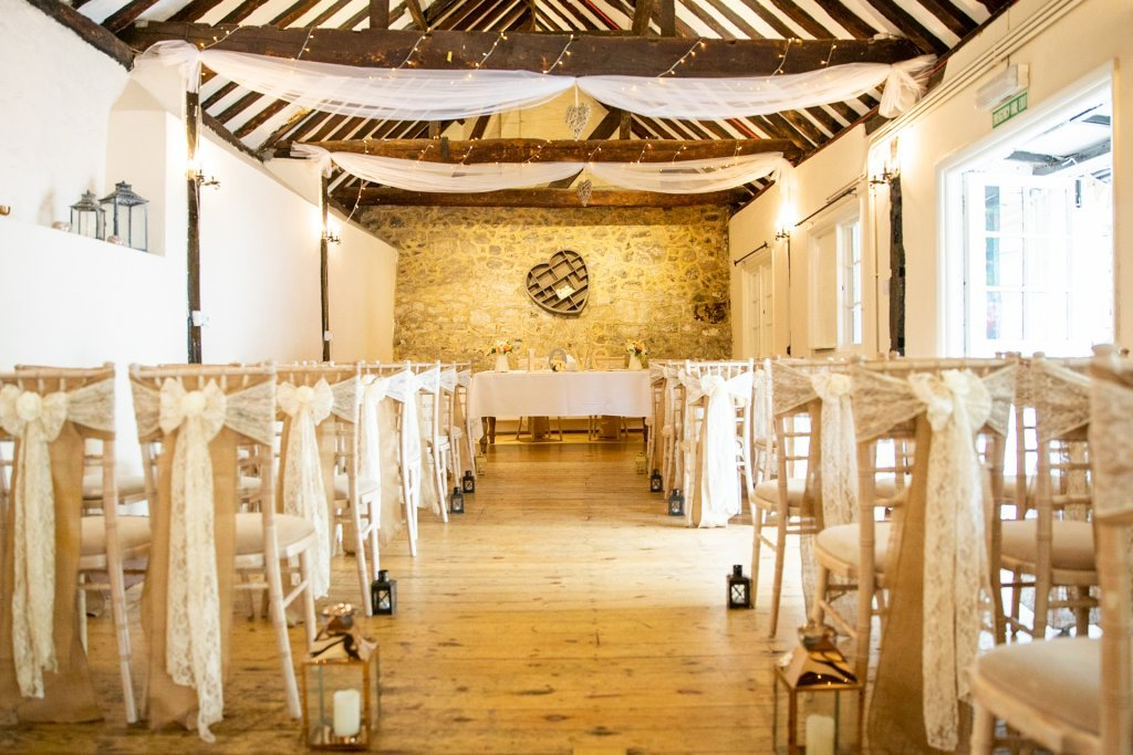 The buttery at The Bull Hotel Wrotham, wedding venue styled with white chair covers detailed with hessian and lace