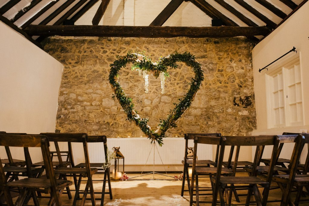 The buttery at The Bull Hotel Wrotham, wedding venue styled with wooden rustic chars and foliage heart