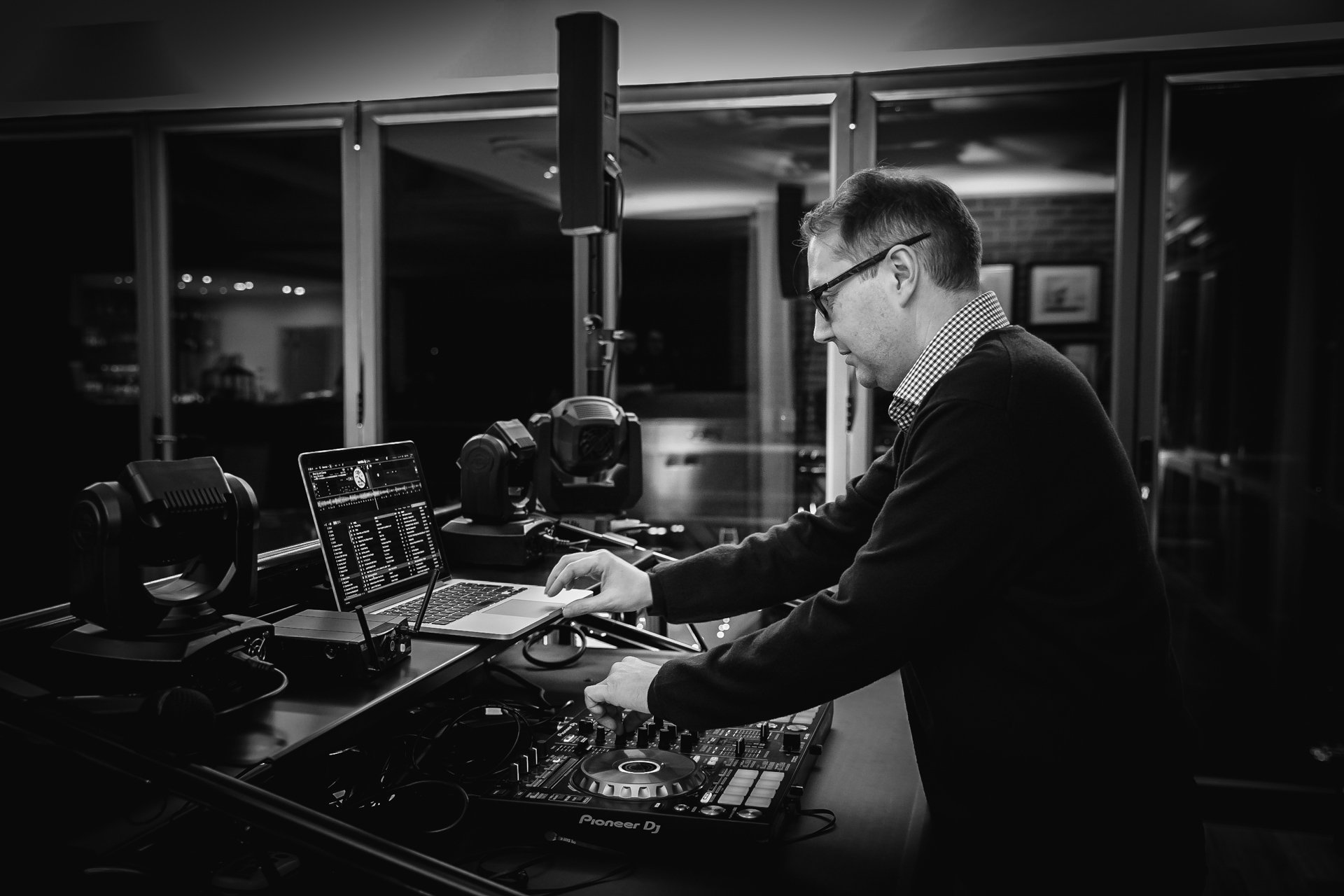 DJ at his decks at Kent Wedding Venue