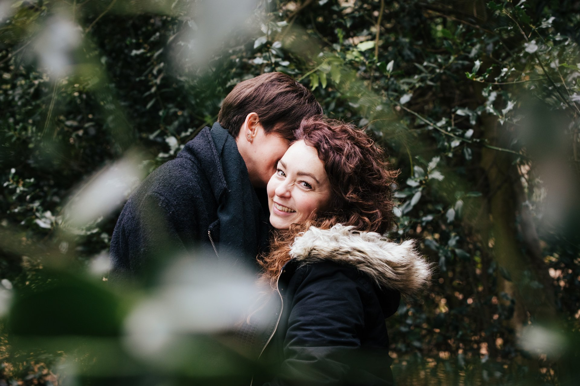 Two gorgeous ladies smiling during their engagement shoot at Shorne Woods Country Park in Kent