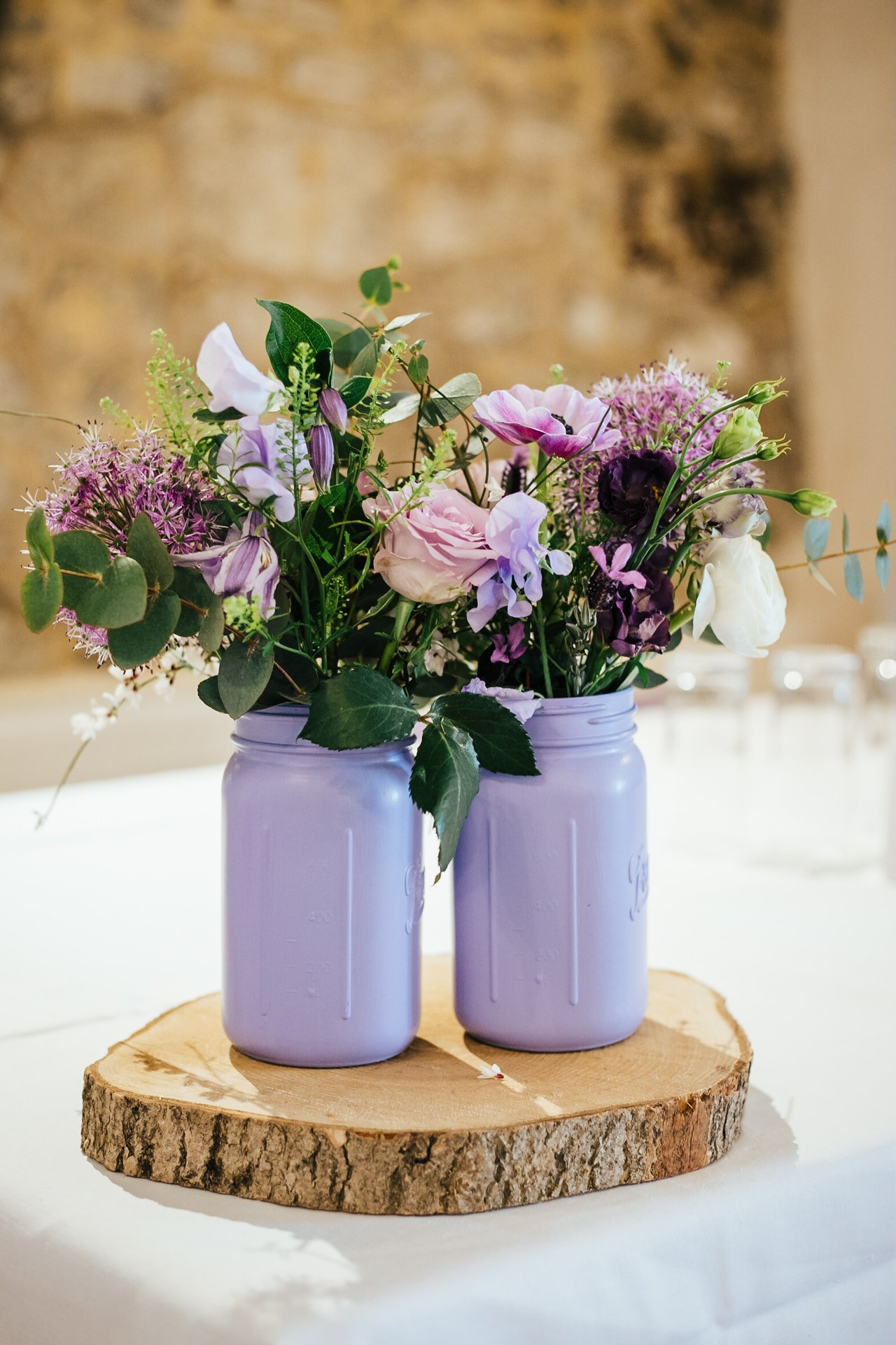 Gorgeous blue, pink and purple floral table decorations in The Bull Hotel Wrotham