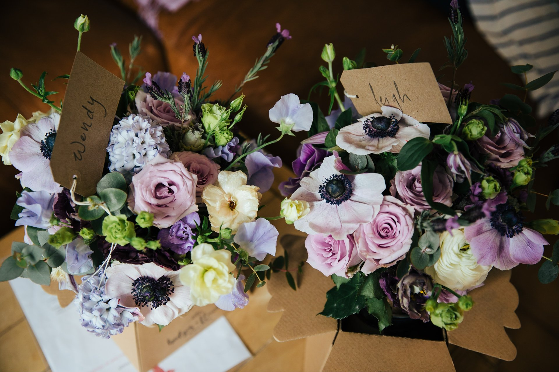 Two gorgeous bridal bouquets with labels for the brides