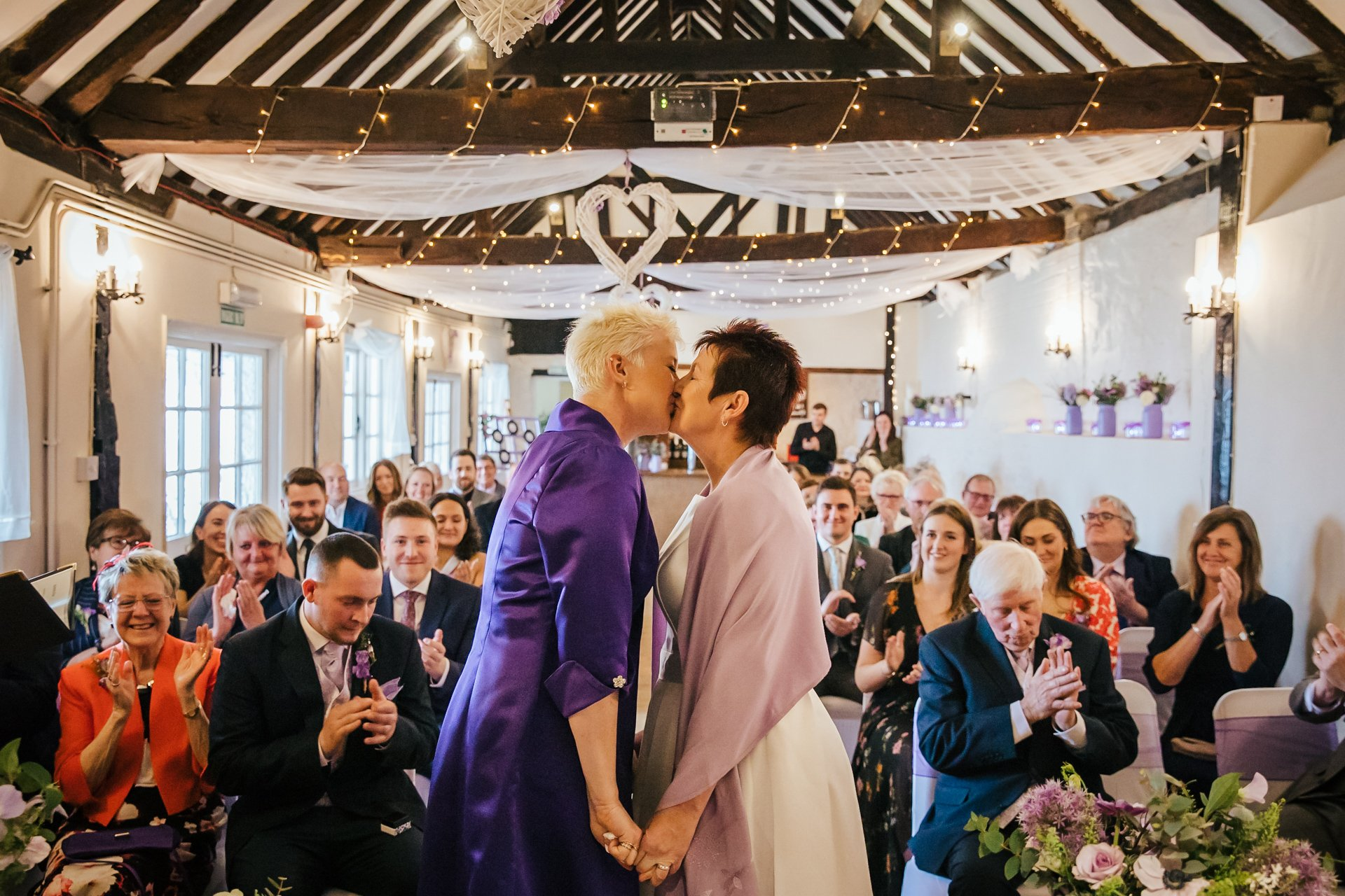 First kiss during the Wedding ceremony of two brides at The Bull Wrotham Kent