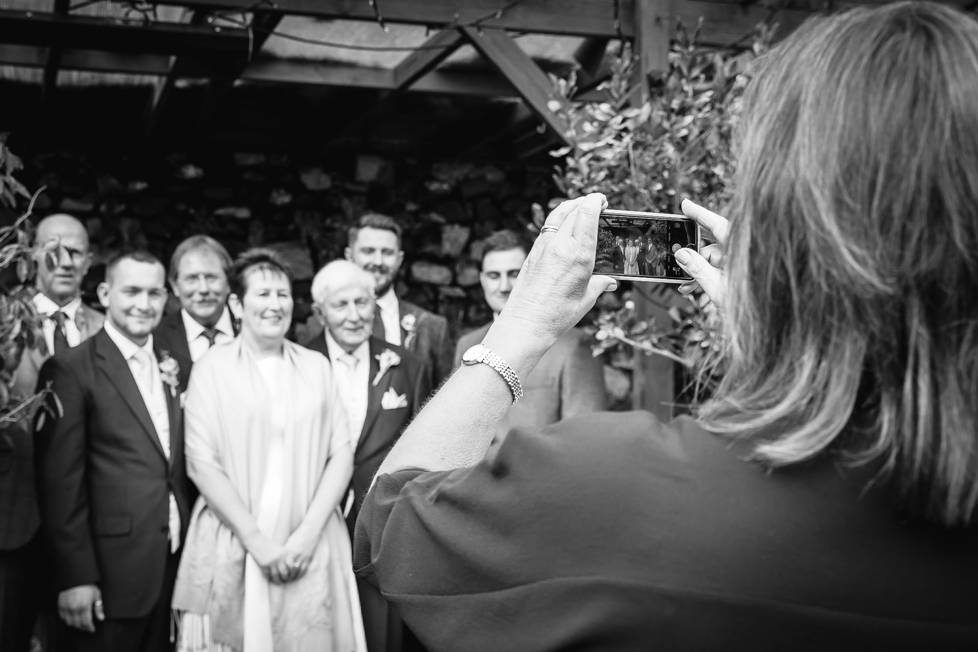 Wedding guest taking a group photograph