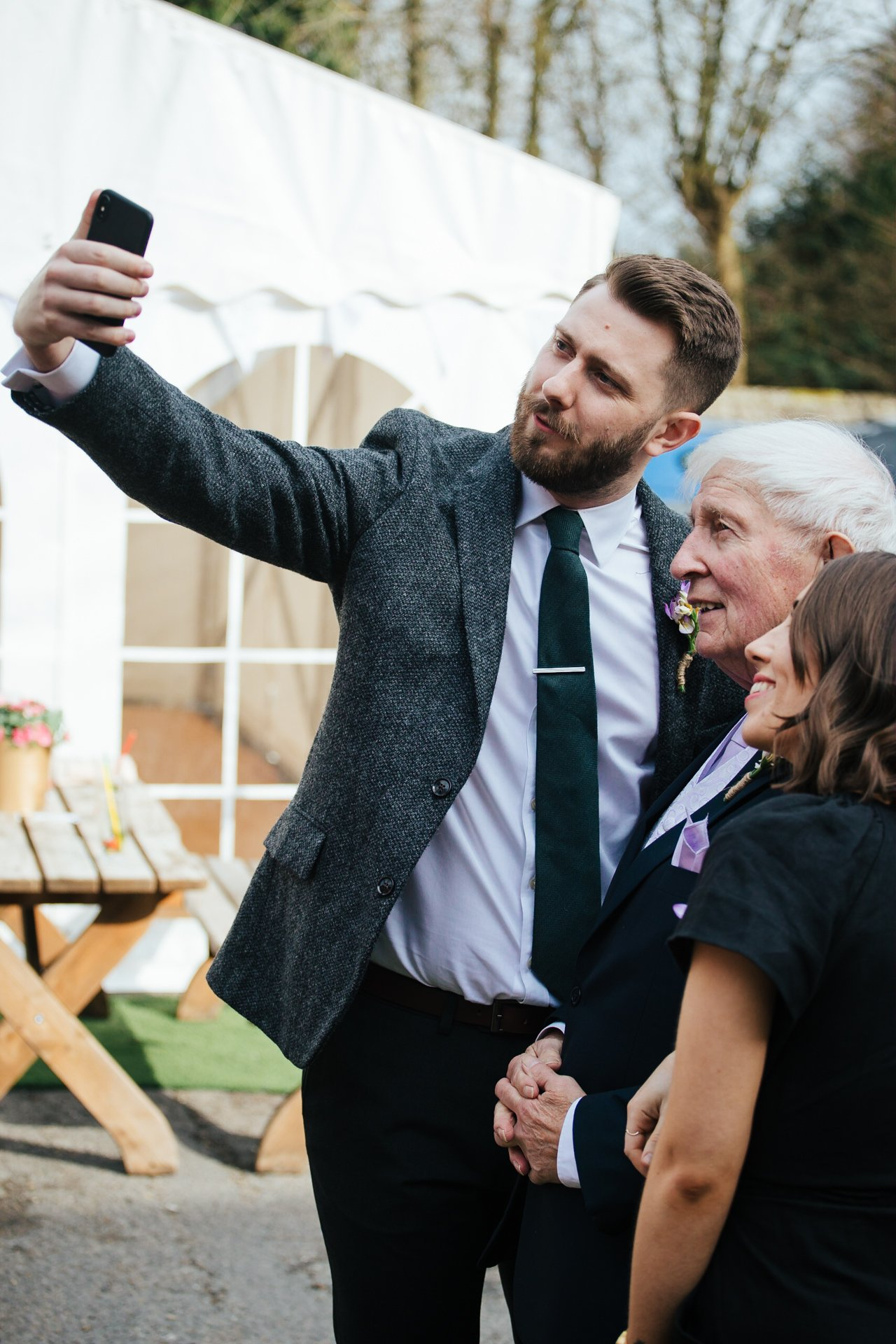 Guests taking a selfie at a wedding at The Bull Hotel Wrotham