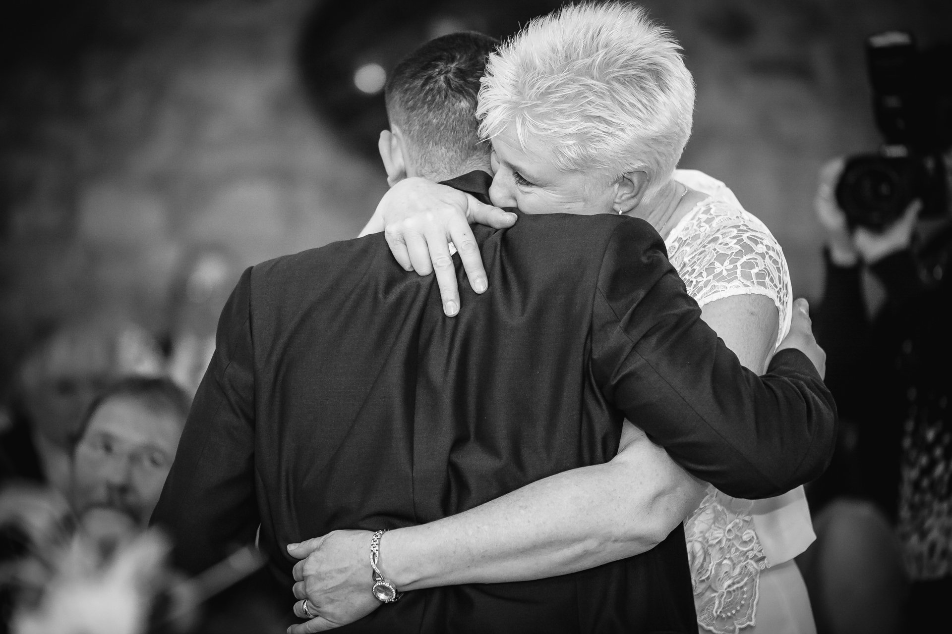Bride and her son embrace after his speech