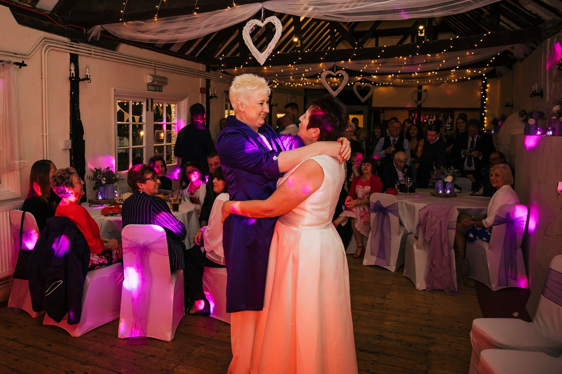Two brides having their first dance in the Buttery at The Bull Hotel Wrotham Kent