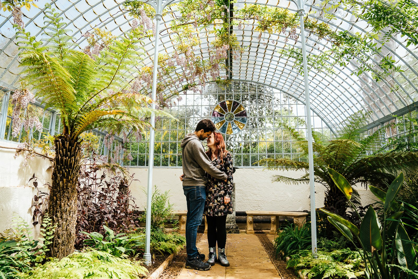 Couple embracing in the grotto and fernery at Swiss Gardens Couple shoot