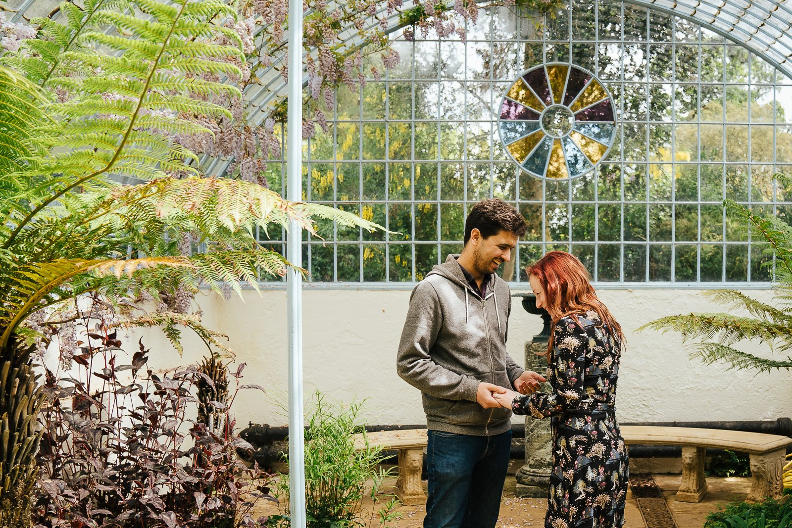 Couple laughing in the grotto and fernery at Swiss Gardens Couple shoot