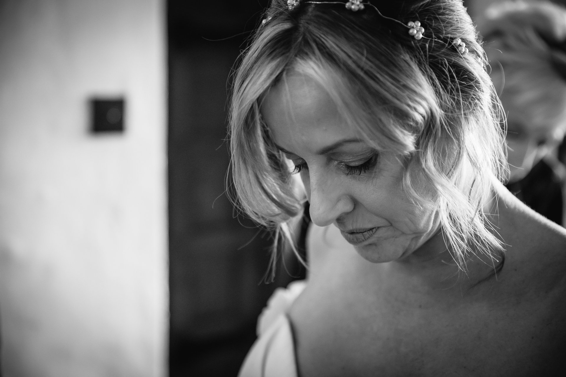 Close up of Bride having help doing up her gorgeous wedding dress in Allington Castle, Kent