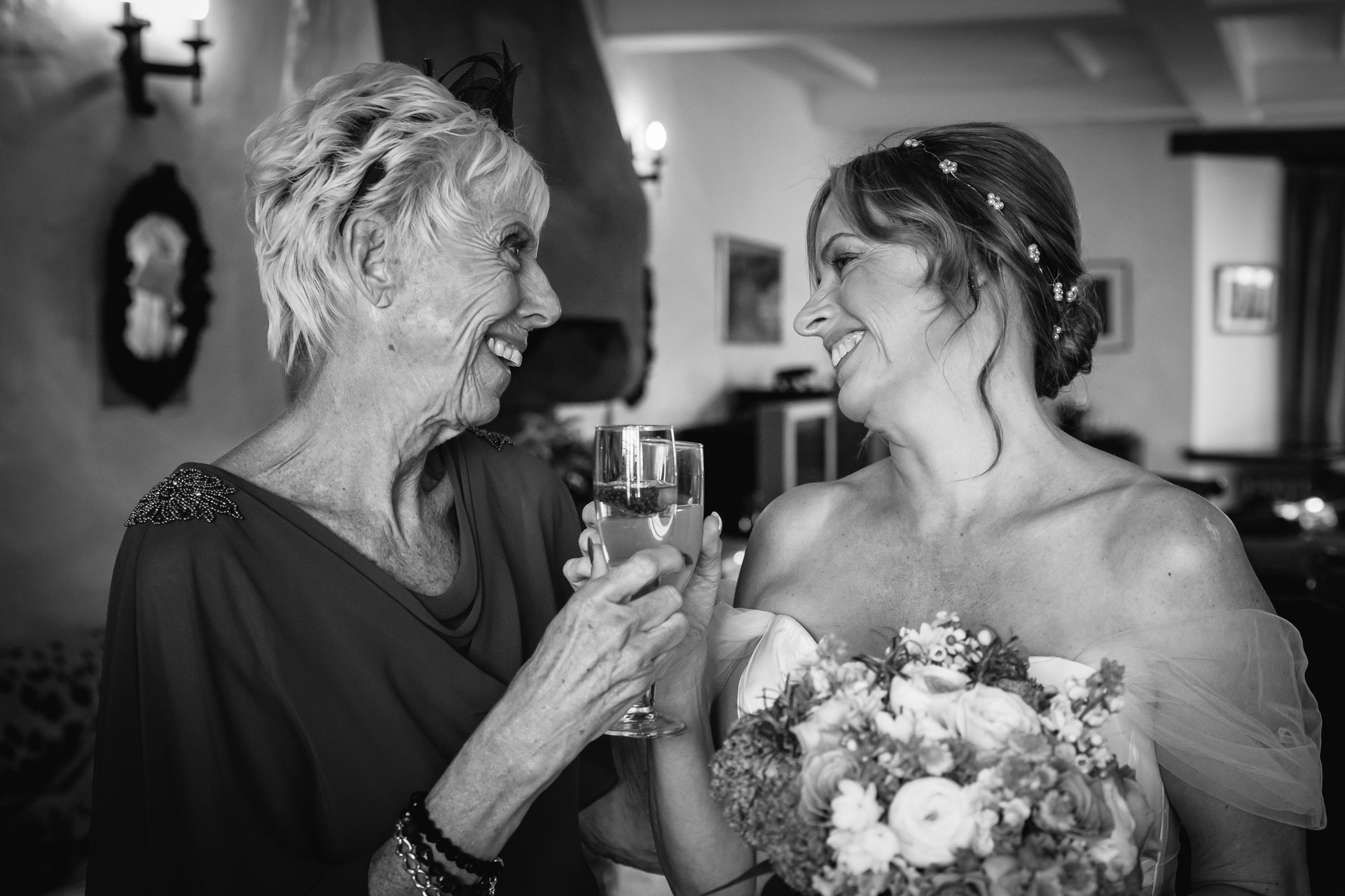 Bride and Mother of the Bride raising a toast before the ceremony