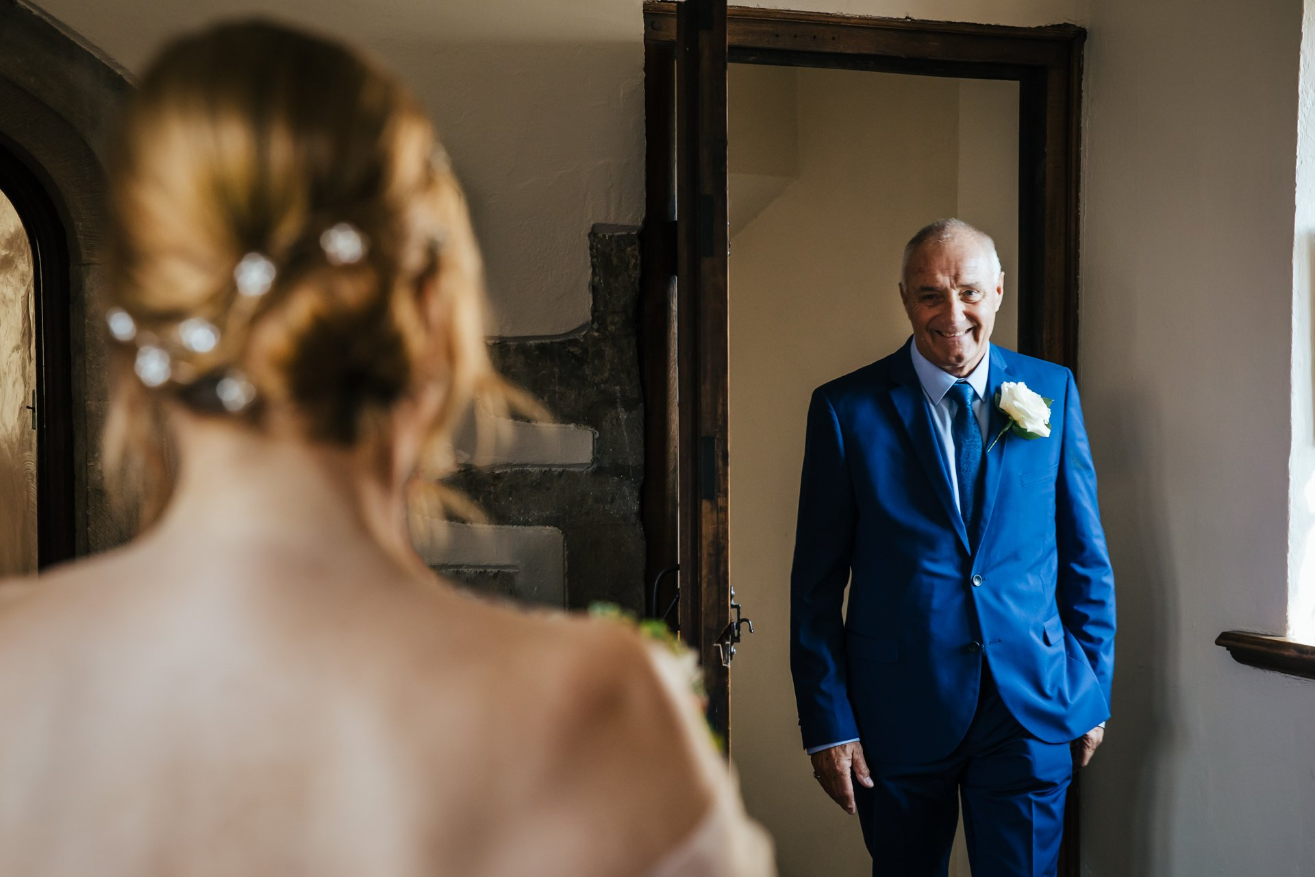Father of the Bride seeing his daughter in her wedding dress for the first time at Allington Castle