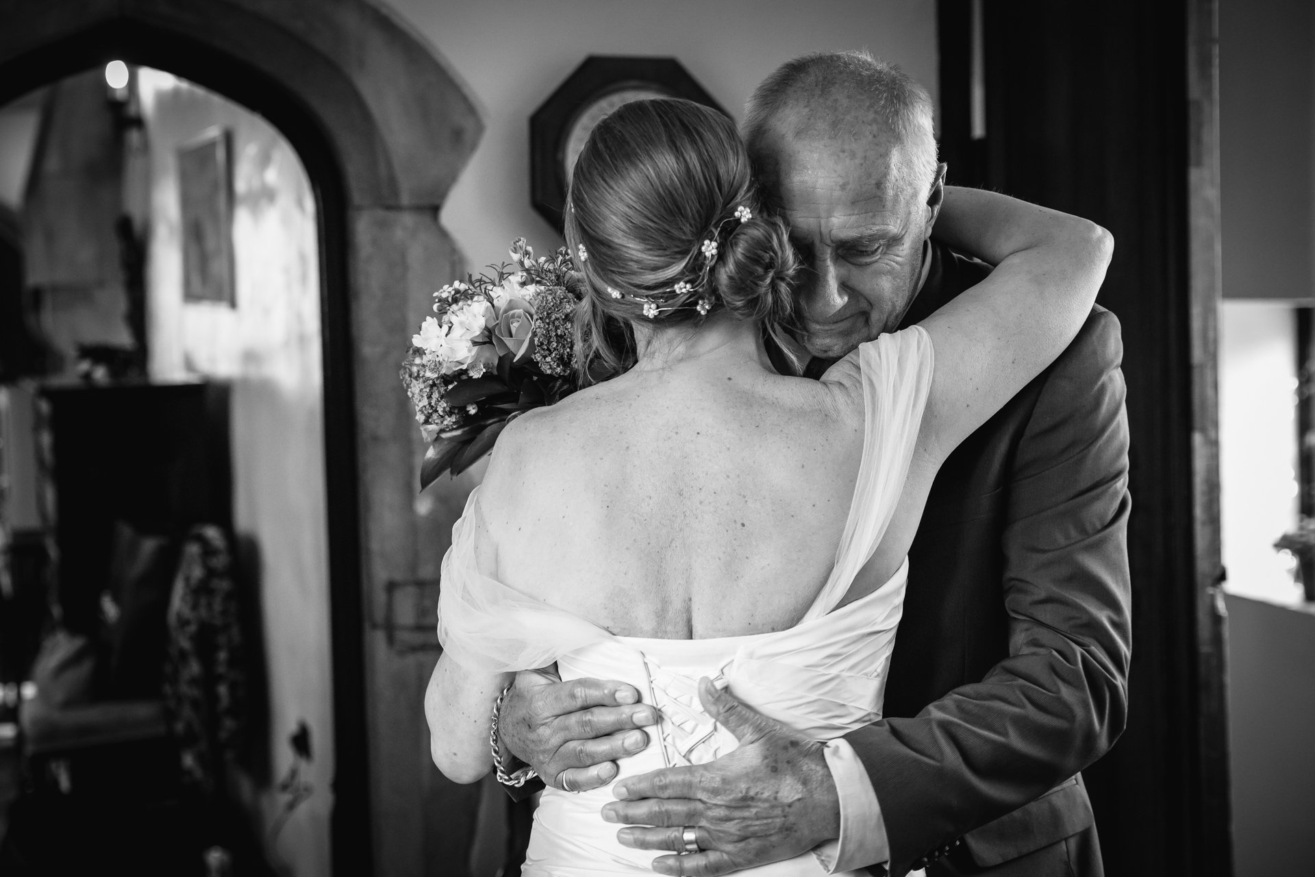 Bride and her father in an emotional embrace before her ceremony