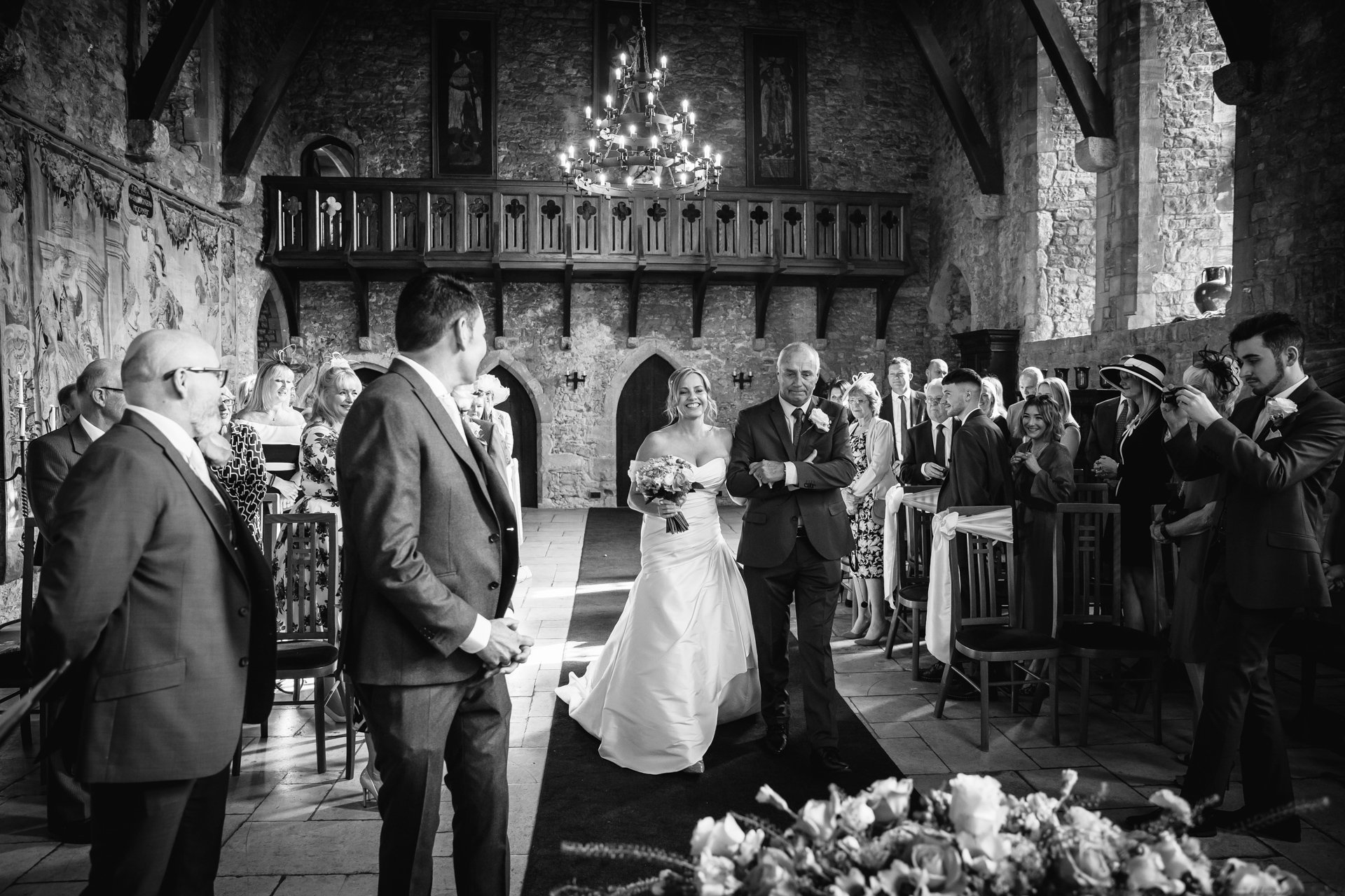 Bride walking down the aisle in the Great Hall, Allington Castle