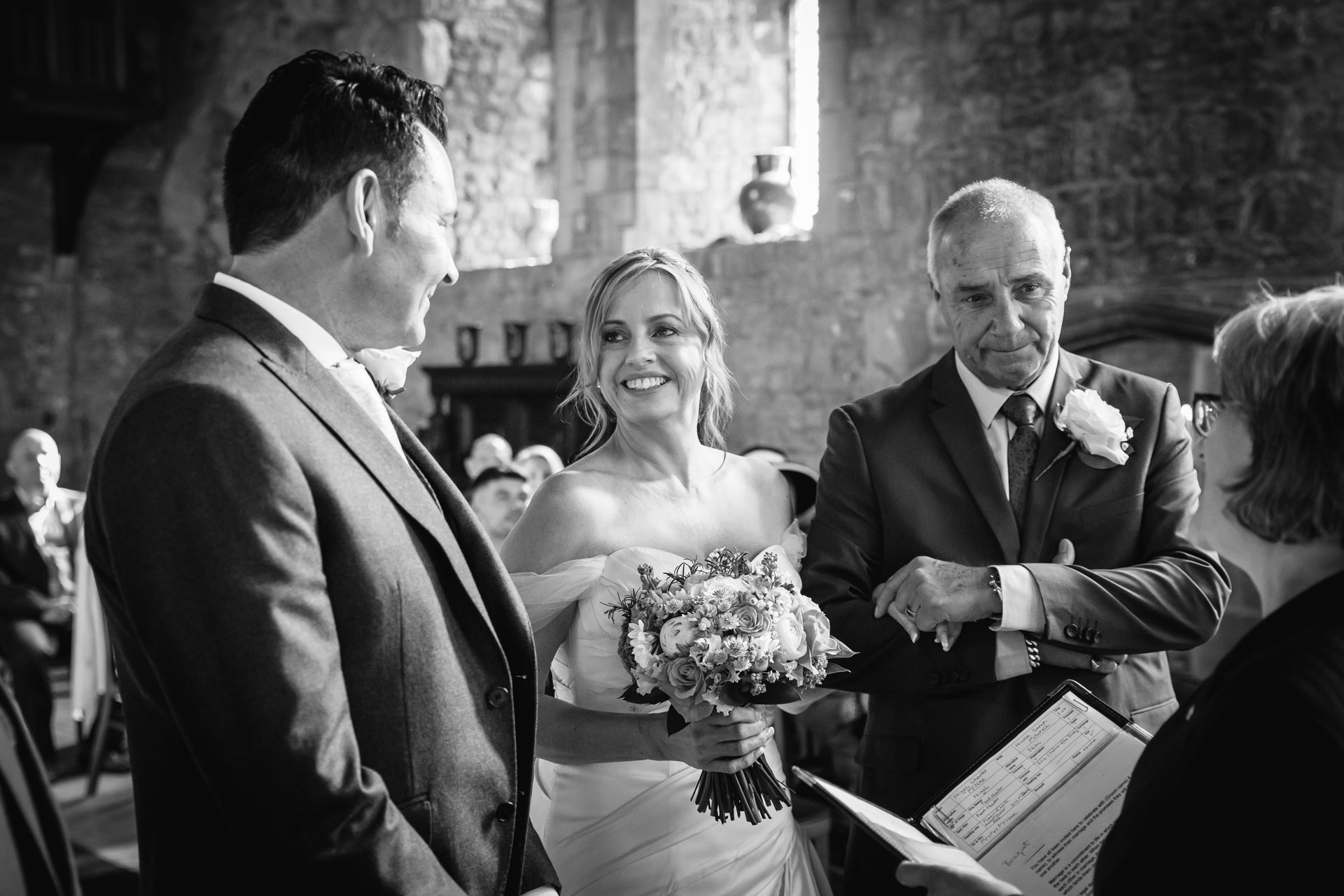 Bride looking lovingly at her Groom in Allington Castle Wedding ceremony