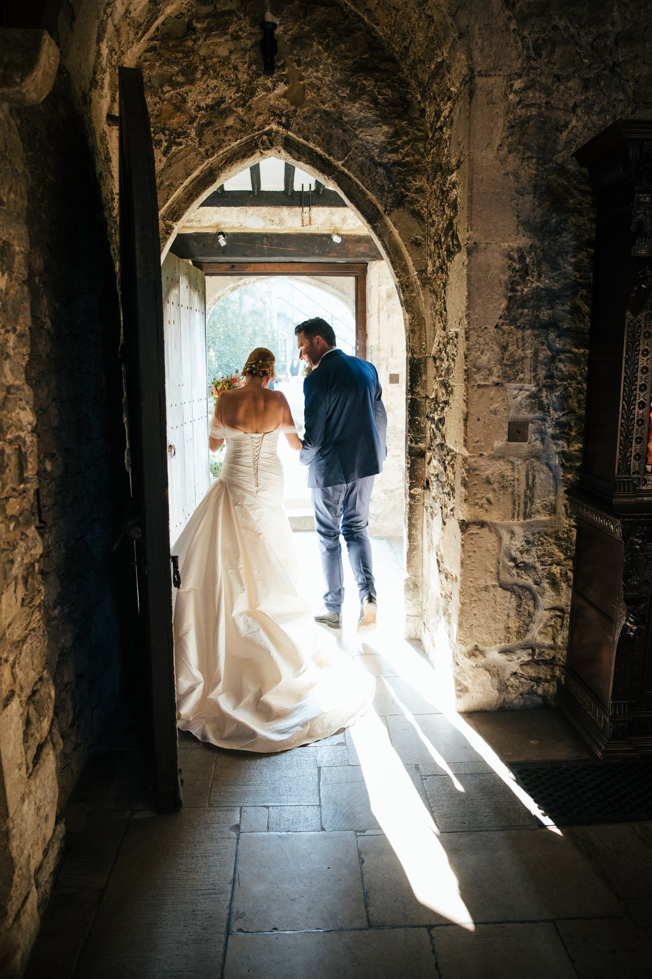 Bride and Groom leaving the Great Hall at Allington Castle