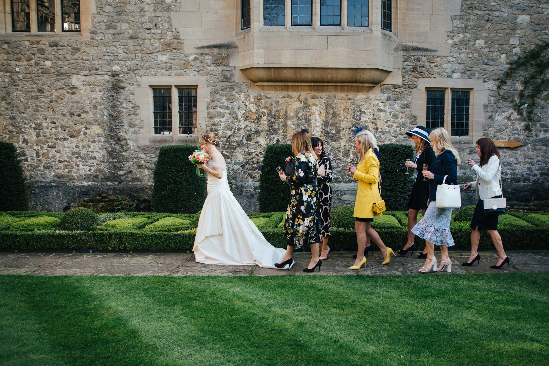 Bride and friends walking to Great Hall in Allington Castle