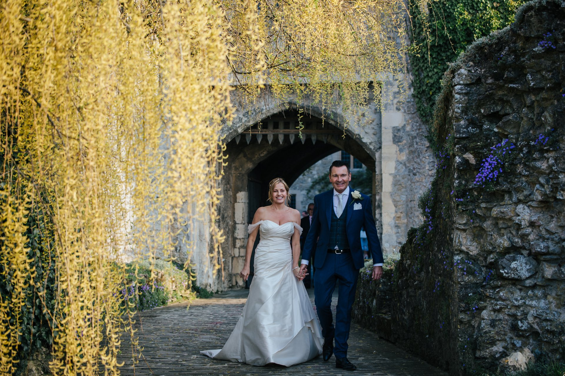 Bride and Groom leaving the gate of Allington Castle after their wedding ceremony