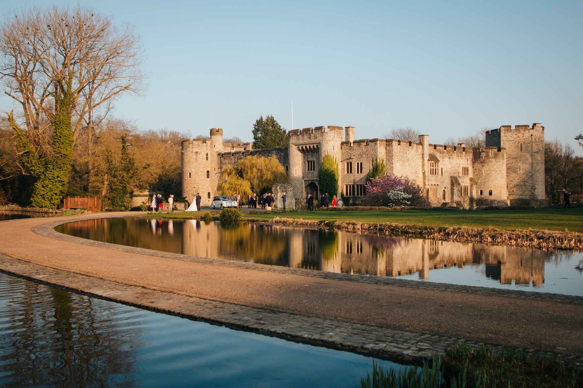 Allington Castle bathed in evening sun with wedding guests