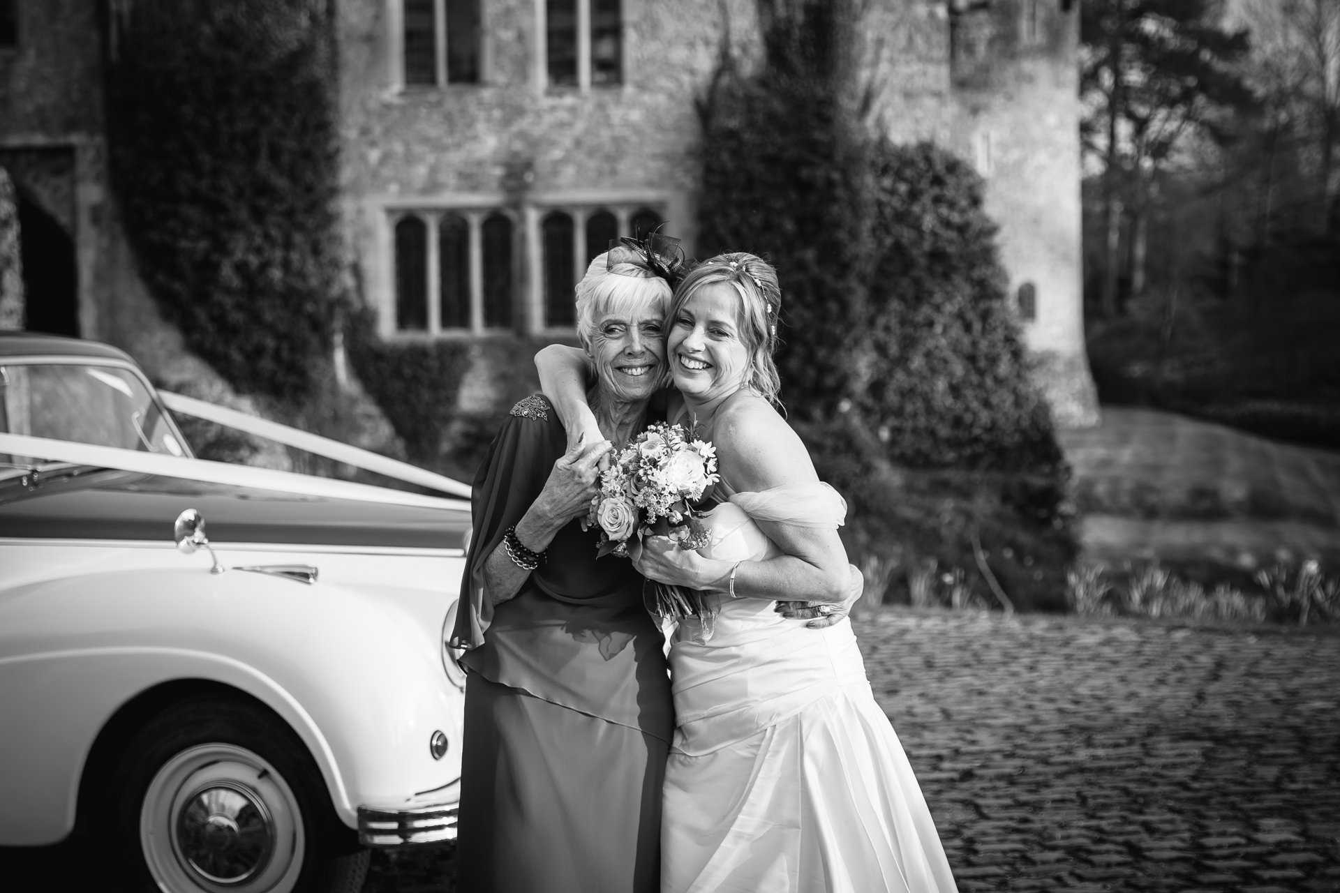Bride and her mother outside Allington Castle, Kent Wedding venue
