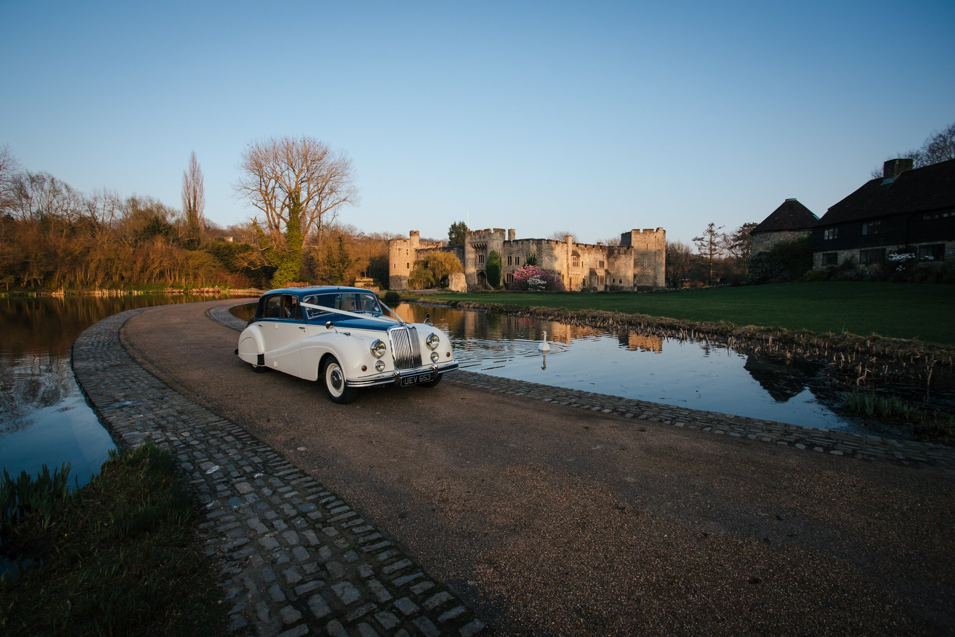 Wedding car with Bride and Groom leaving Allington Castle, Kent Wedding venue