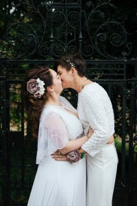 Two brides kissing after their Kent wedding ceremony