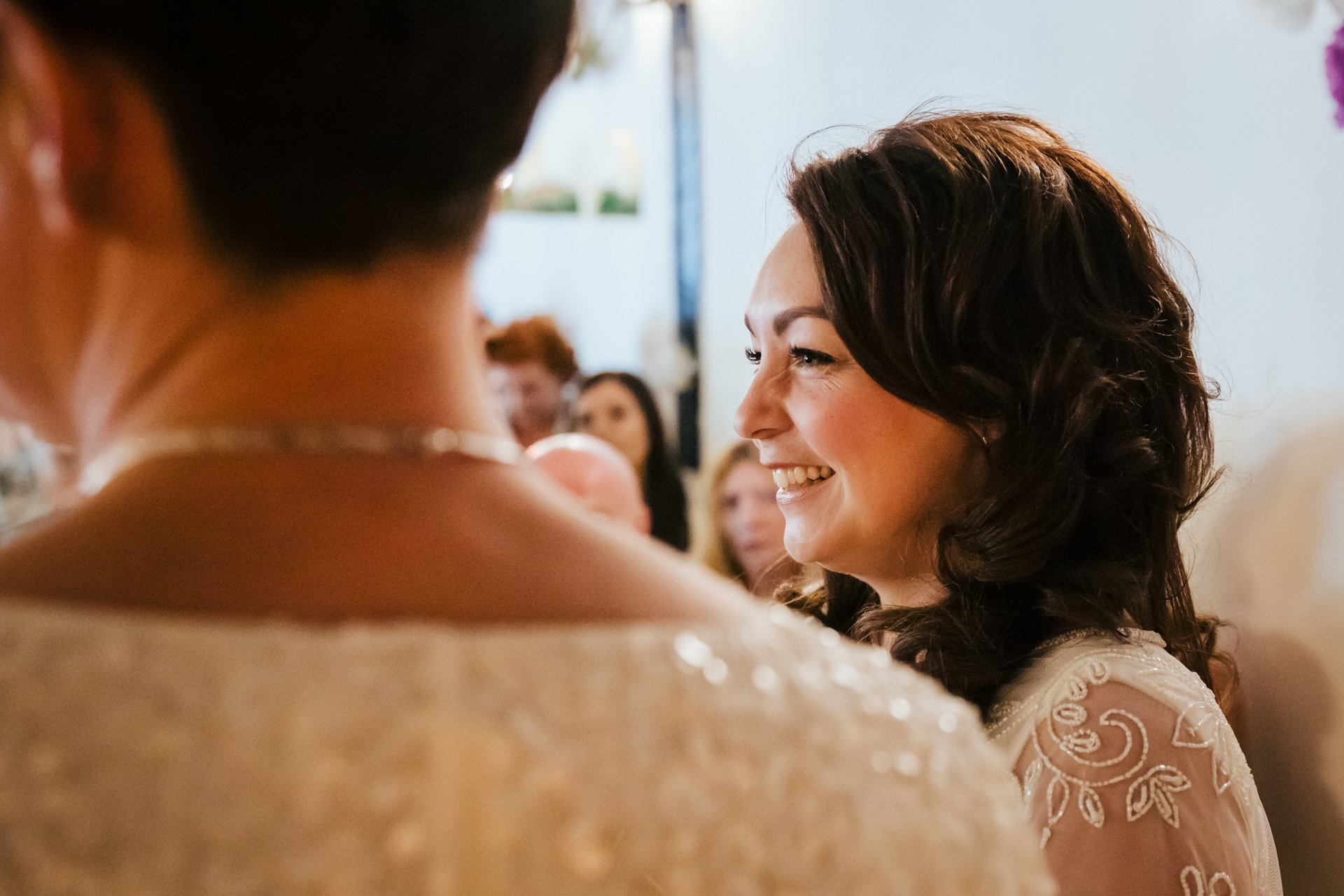 Beautiful smiling bride during their wedding ceremony at The Bull Hotel, Kent