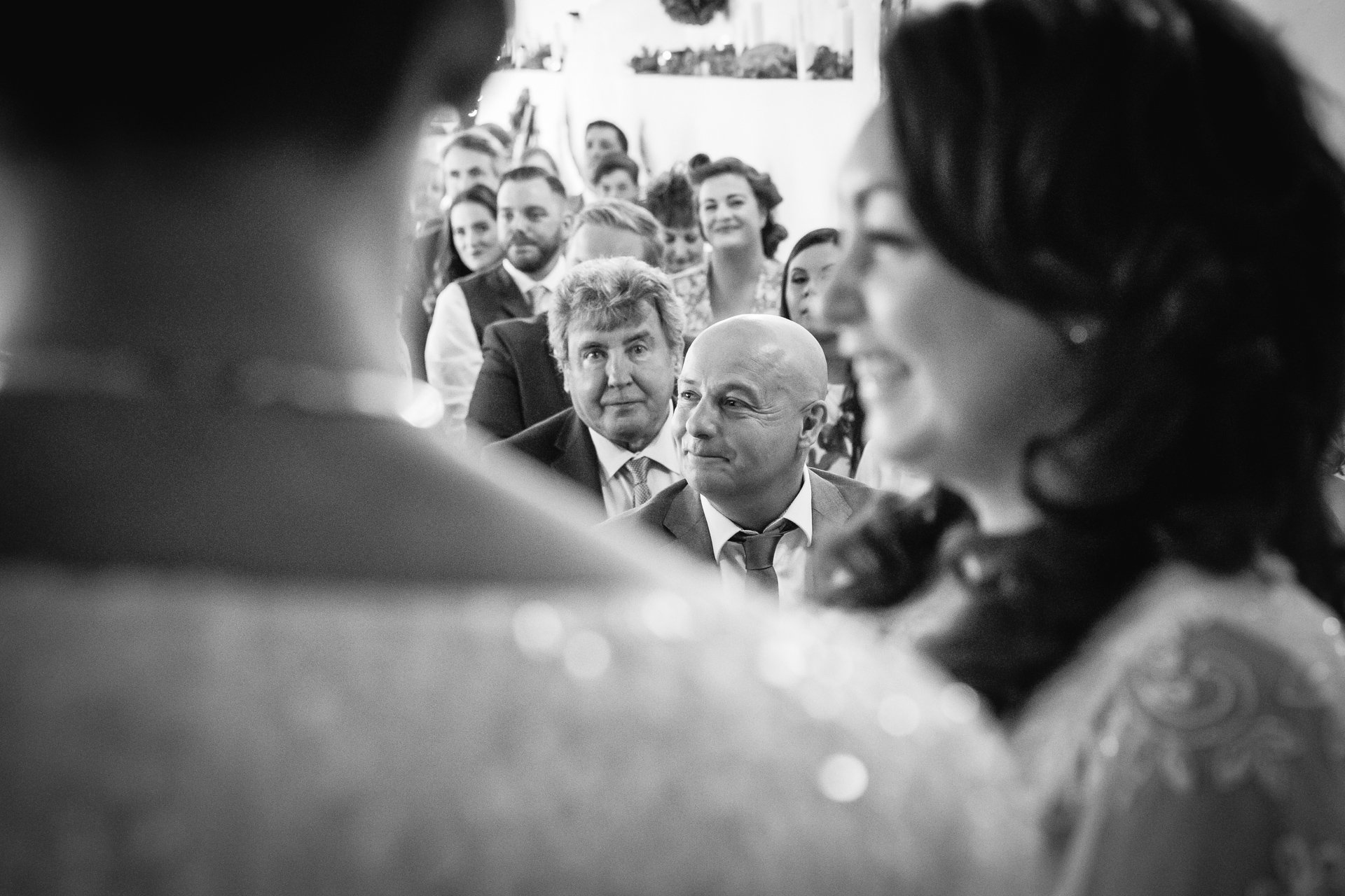 Proud onlookers during the ceremony of two brides at The Bull Hotel in Kent