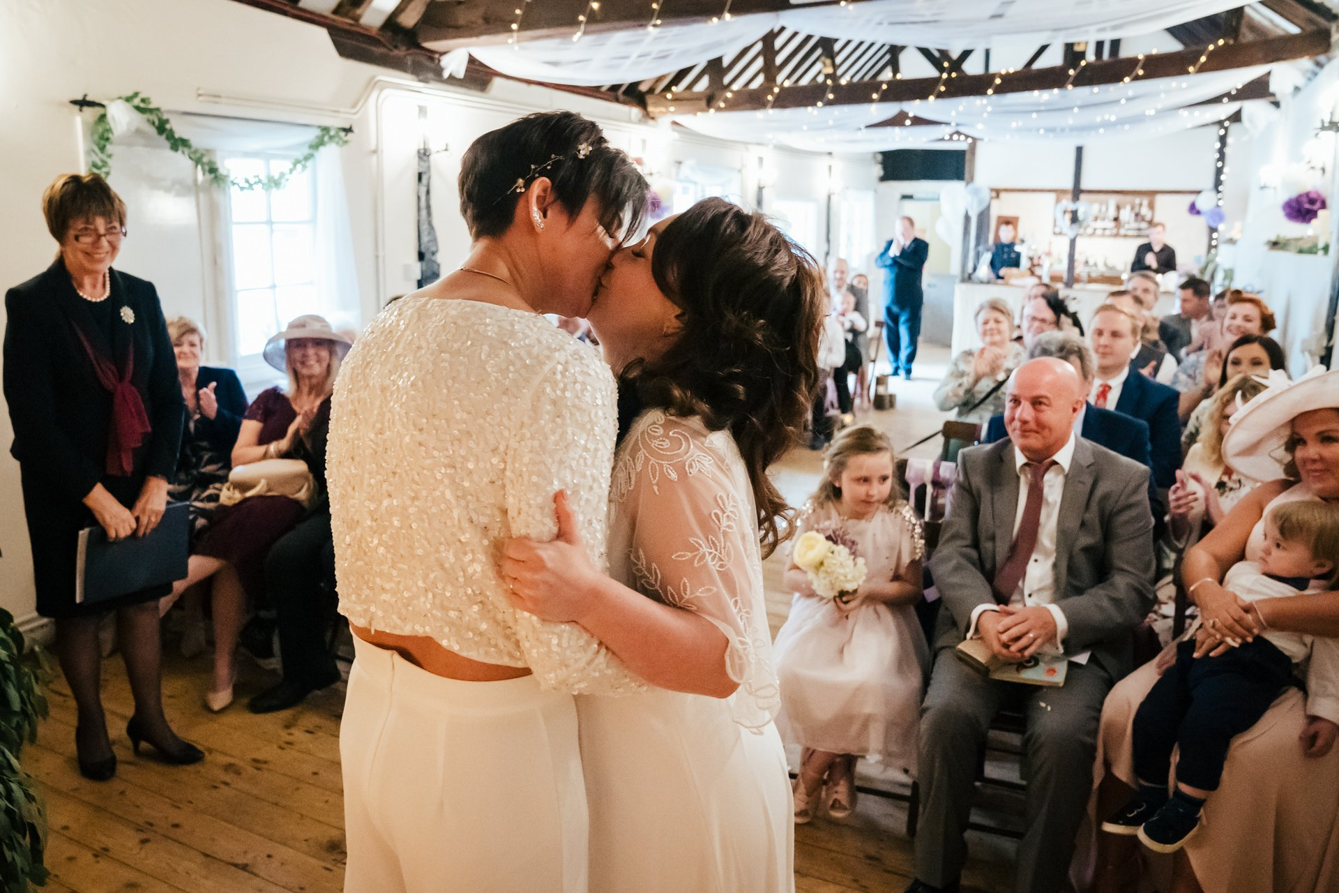 First kiss during the ceremony of two brides at The Bull Hotel, Kent
