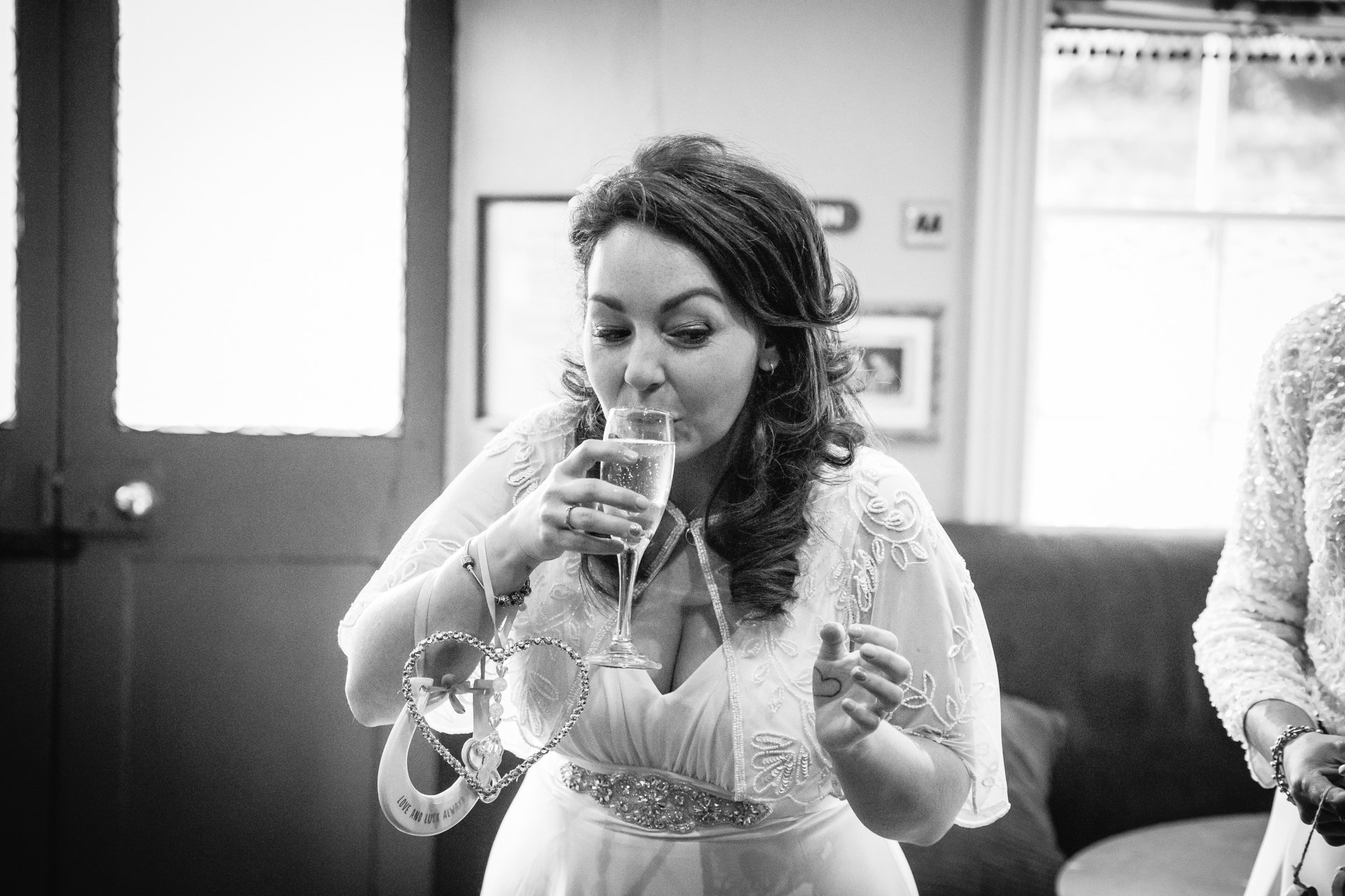 Bride drinking Champagne after their wedding
