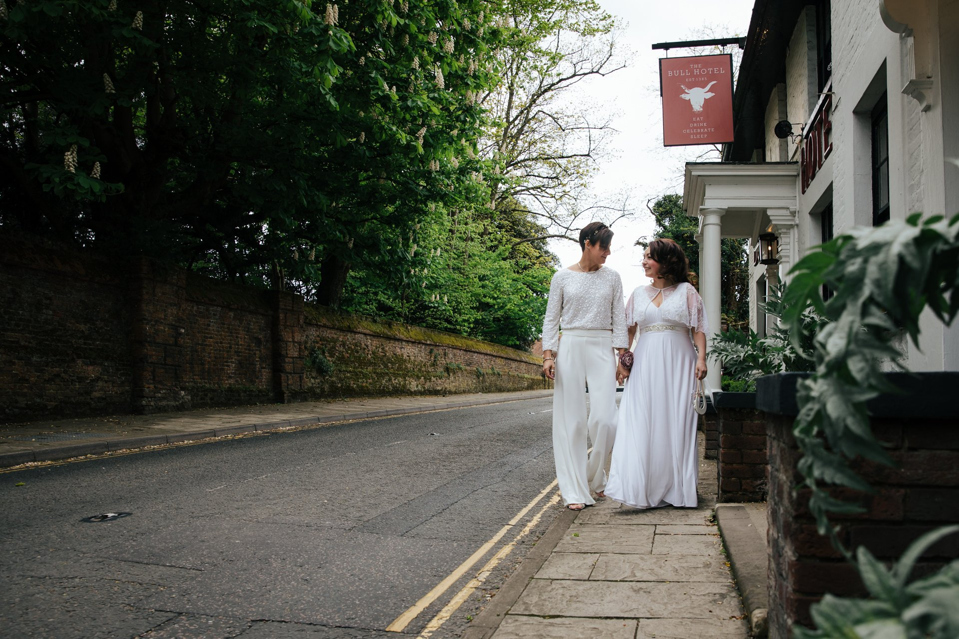 Two brides outside the Bull Hotel Wrotham after their Wedding