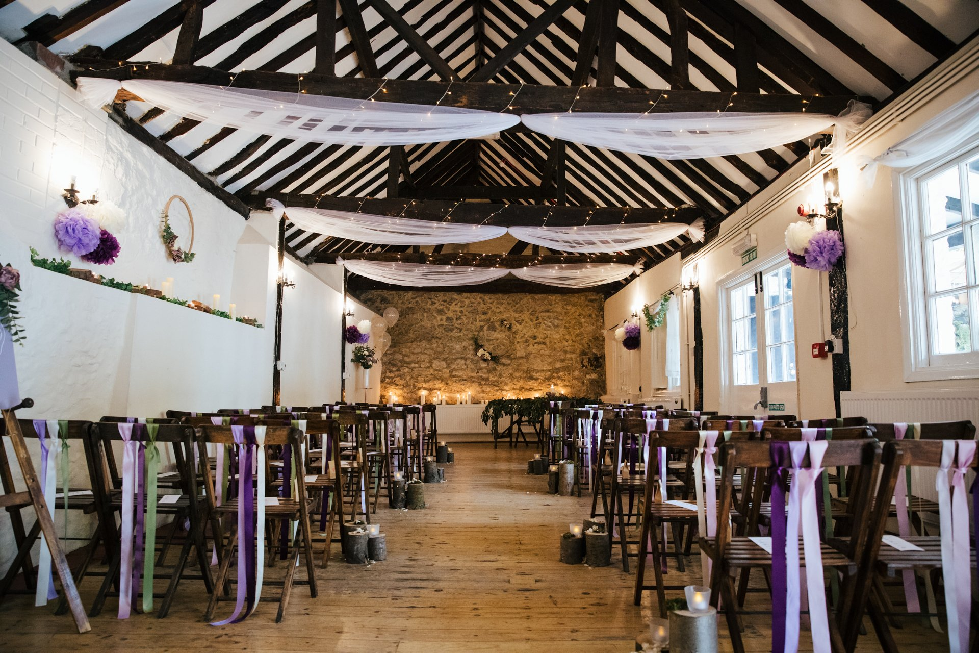 The interior of the Buttery, The Bull Hotel's ceremony room, decorated for a rustic wedding