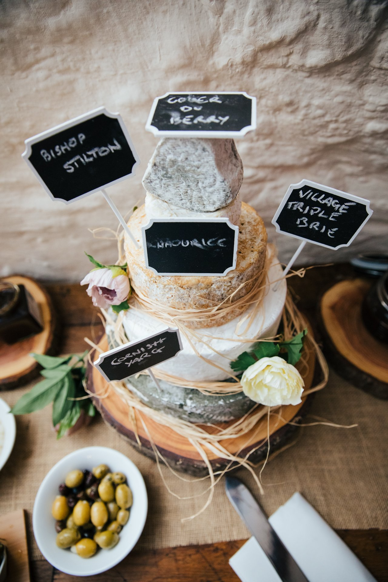 Tiered tower of Cheeses at Wedding Reception