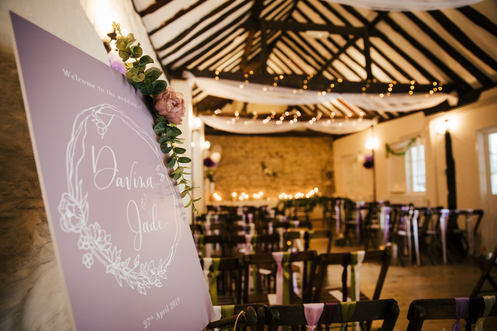 Welcome sign for Jade and Davina's wedding at The Bull Hotel in the beautifully decorated Buttery ceremony room
