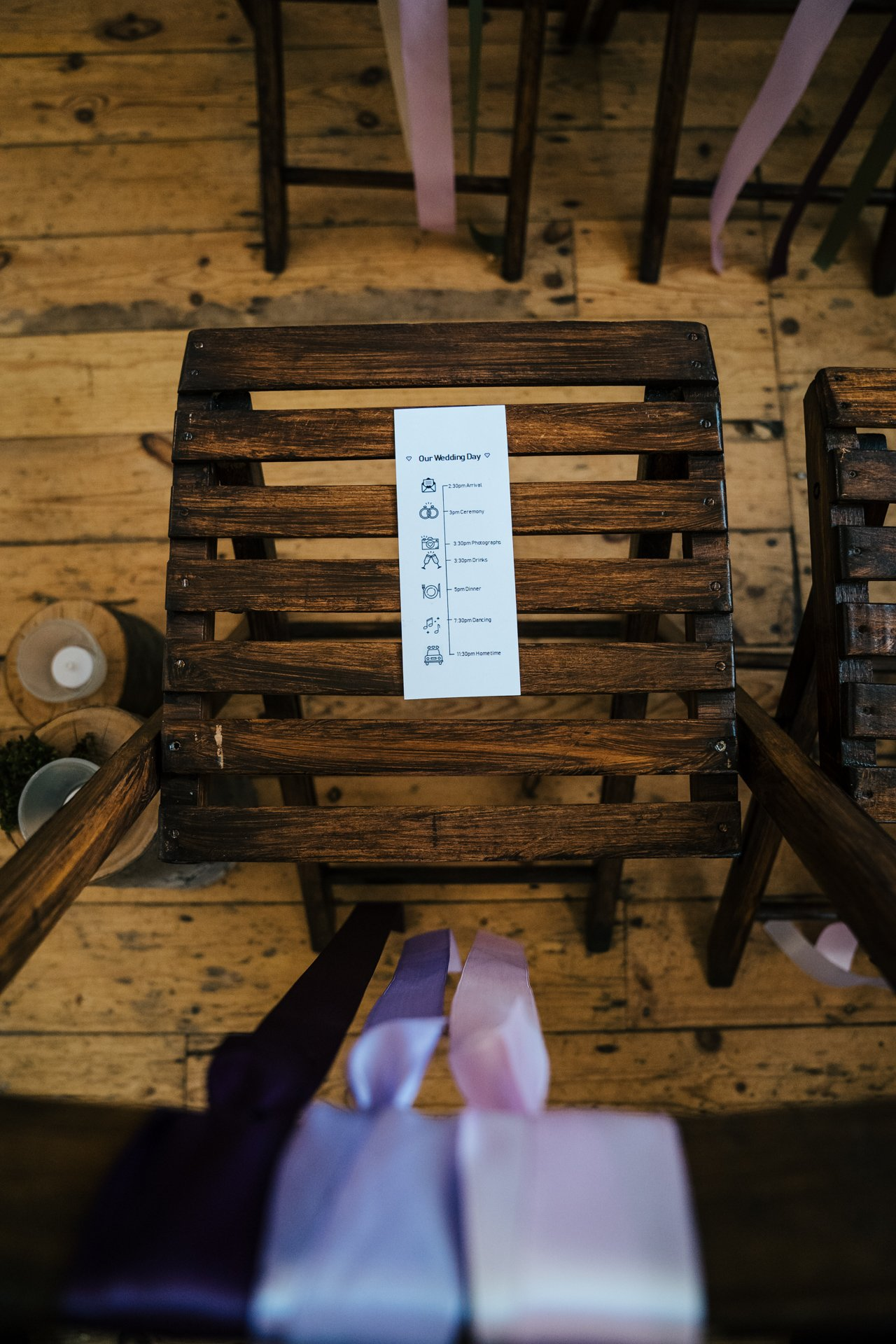 Wedding timeline on the rustic chairs of Locate to Create at The Bull Hotel, Kent