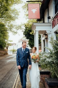 Couple outside the Bull Hotel Wrotham for their wedding portraits