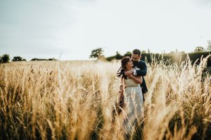 Newly wed couple in gorgeous golden hour portrait