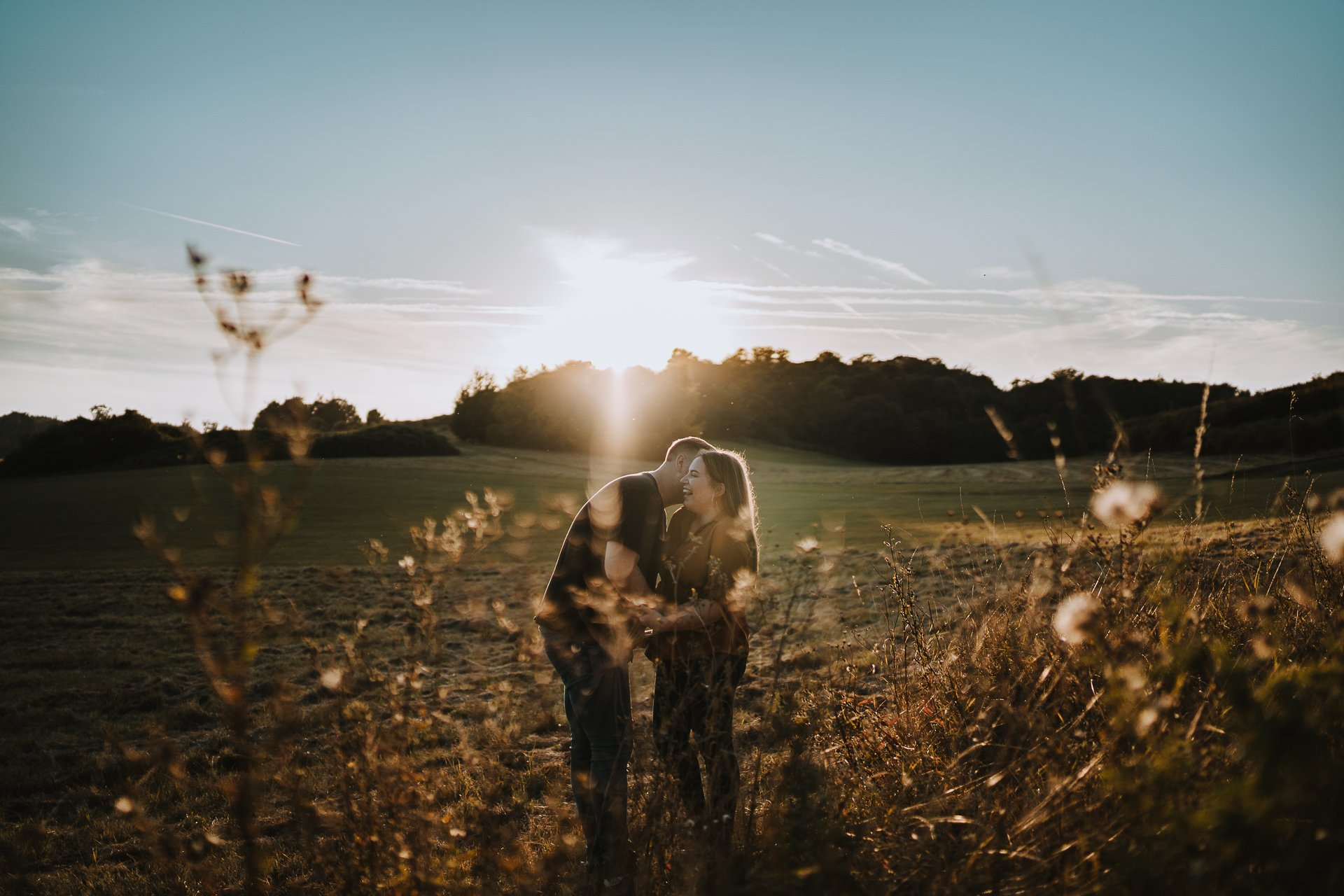 Engaged couple laughing during their golden hour couple shoot at Lullingstone Country Park, Kent