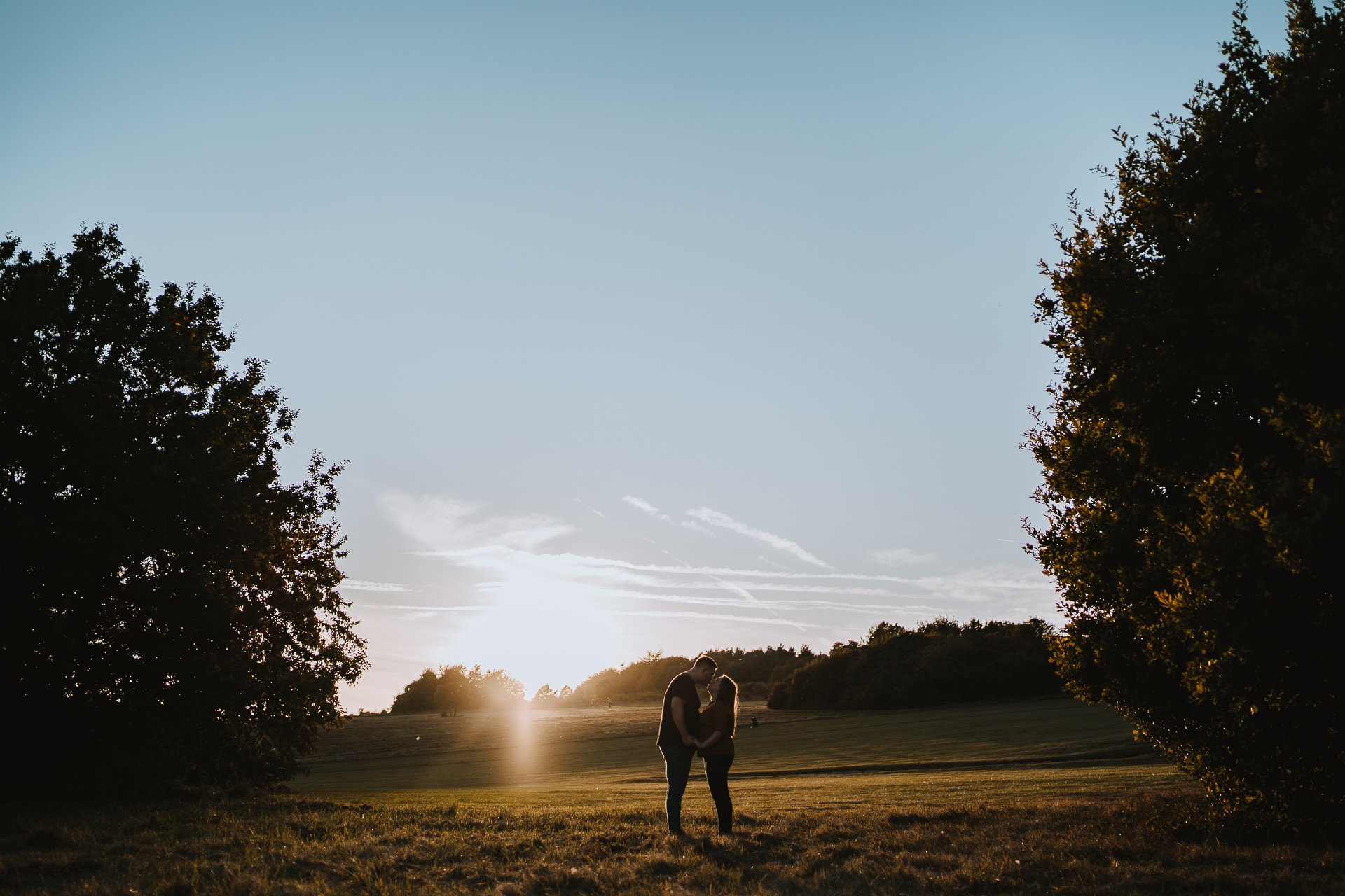 Engaged couple kissing during their golden hour couple shoot at Lullingstone Country Park, Kent